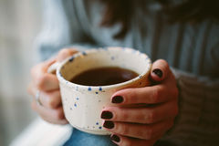 Young woman hands holding a cup Stock Photography