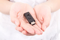 Young woman hands holding flash drive Stock Image