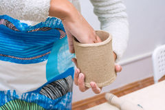 Young Woman Hands Making a Cup of Raw Clay. Master Class at Ceramic Workshop Stock Images