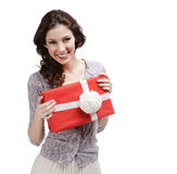Young woman hands a present with white bow. Young woman hands a present wrapped in red paper with white bow, isolated on white Royalty Free Stock Photos