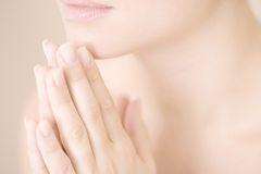 Young woman with hands together, praying or meditating Stock Photography