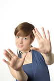 Young woman with hands toward the camera Royalty Free Stock Photography