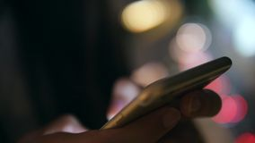 Young Woman Hands Using Smartphone with Blurred Bokeh Street Urban Night Road Lights Background. 4K. Bangkok, Thailand. Young Woman Hands Using Smartphone with stock video footage