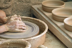Young woman hands working on pottery wheel Royalty Free Stock Photography