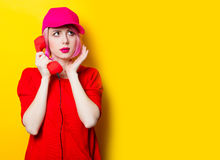 Young woman with handset Stock Images
