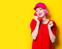 Young woman with handset Royalty Free Stock Photo