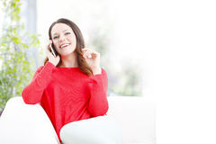 Young woman with handy Stock Photo