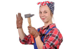 Young woman handyman drive a nail Royalty Free Stock Photos