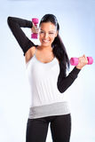 Young woman hang up hands weights stock image