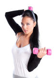 Young woman hang up hands weights royalty free stock images