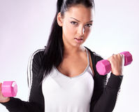 Young woman hang up hands weights stock photography