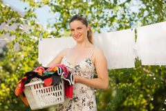 Young woman hanging laundry Royalty Free Stock Photo