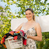 Young woman hanging laundry Royalty Free Stock Image