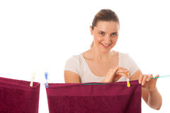 Young woman hanging laundry isolated Stock Image