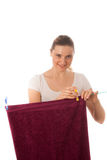 Young woman hanging laundry isolated Royalty Free Stock Images