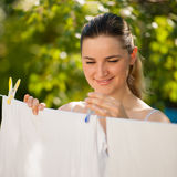 Young woman hanging laundry outdoor Stock Photos