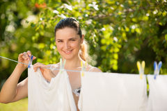Young woman hanging laundry outdoor Royalty Free Stock Photos