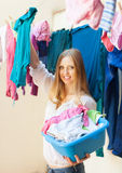 Young woman hangs clothes to dry Stock Images