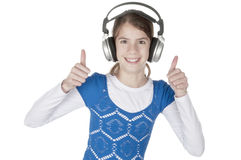 Young woman happily listening headphone Royalty Free Stock Images