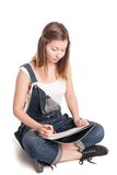 Young woman happily sitting cross-legged on the Royalty Free Stock Photo