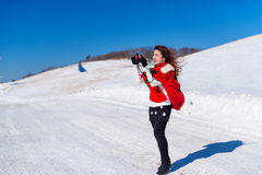 Young woman is a happiness with camera in winter. Royalty Free Stock Photos