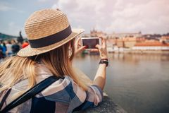 Young woman happy with backpack tourist taking selfie photo camera on Charles Bridge in Prague, Czech Republic. Concept royalty free stock images