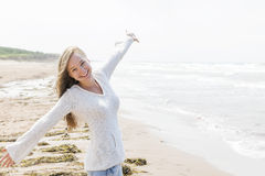Young woman happy on beach Stock Image