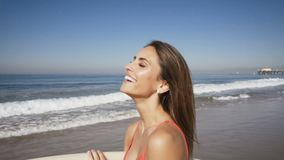 Young woman happy at the beach. summer feeling stock video footage