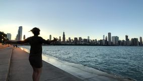 Young woman is happy from being in Chicago, she is spinning stock footage