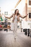 Young woman happy bounces  in the street royalty free stock photography