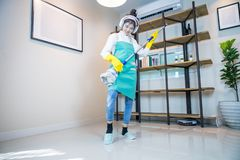 Young woman happy and cleaning home, royalty free stock photos