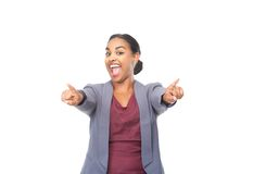 Young woman with happy expression pointing fingers Royalty Free Stock Photography