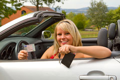 Young woman happy about her new drivers license Royalty Free Stock Photo