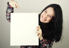 Young woman happy holding blank sign Stock Photography