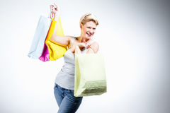 Young woman happy holding colored bags Stock Photos