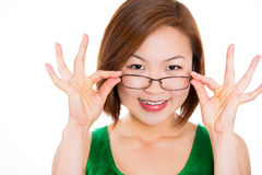 A young woman happy holding showing her new glasses smiling Stock Photo