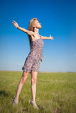 Young woman happy on a nature Royalty Free Stock Photo