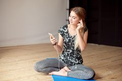 Young woman happy singing her favorite song while listening music sitting on the floor. Young woman happy singing her favorite song while listening music royalty free stock photos
