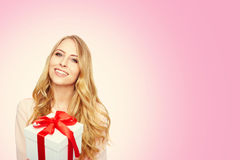 Young woman happy smile hold gift box in hands. Royalty Free Stock Images