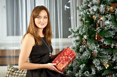 Young woman happy smile hold gift box in hands Stock Photography