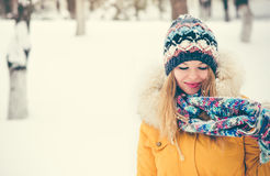 Young Woman happy smiling wearing hat and scarf walking outdoor Stock Image