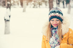Young Woman happy smiling wearing hat and scarf walking outdoor Stock Photography