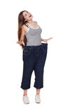 Young woman happy of weight loss diet results, isolated Royalty Free Stock Photo