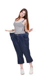 Young woman happy of weight loss diet results, isolated Stock Images