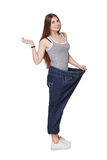 Young woman happy of weight loss diet results, isolated. Young happy woman delighted with diet results, isolated on white. Girl celebrates weight loss success Stock Photography