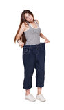Young woman happy of weight loss diet results, isolated. Young happy woman delighted with diet results, isolated on white. Girl celebrates weight loss success Royalty Free Stock Images