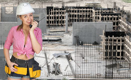 Young woman in hard hat holding walkie talkie Stock Photo