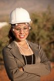 Young woman in hard hat and safety goggles Royalty Free Stock Photography