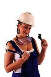 Young woman with hard hat and tools Royalty Free Stock Image