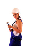 Young woman with hard hat and tools. On white background royalty free stock photos
